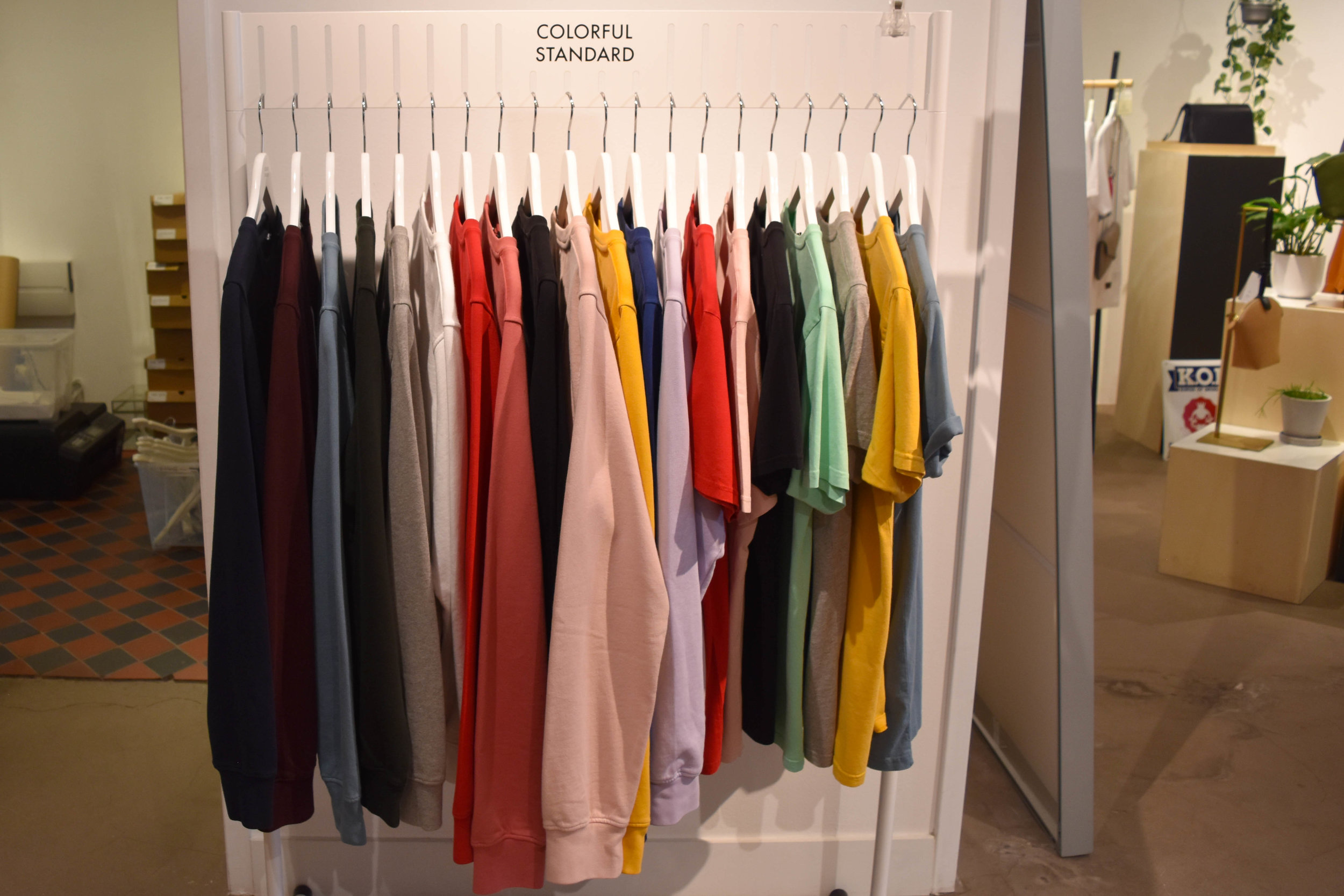 A rack of  Colorful Standard : colorful (hehe) organic, logo free t-shirts and sweats.