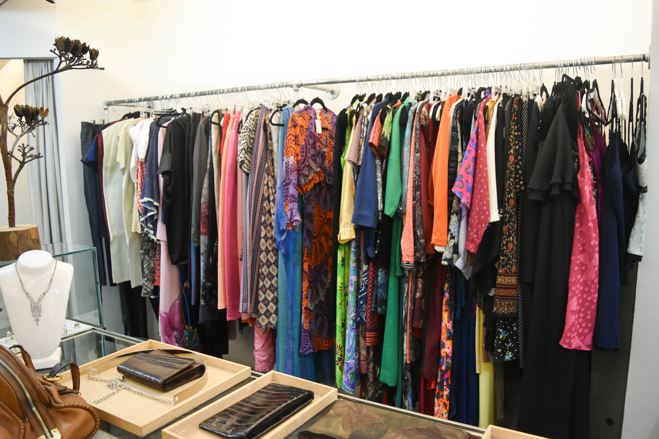You will find colorful vintage blouses and dresses, designer and non-designer.
