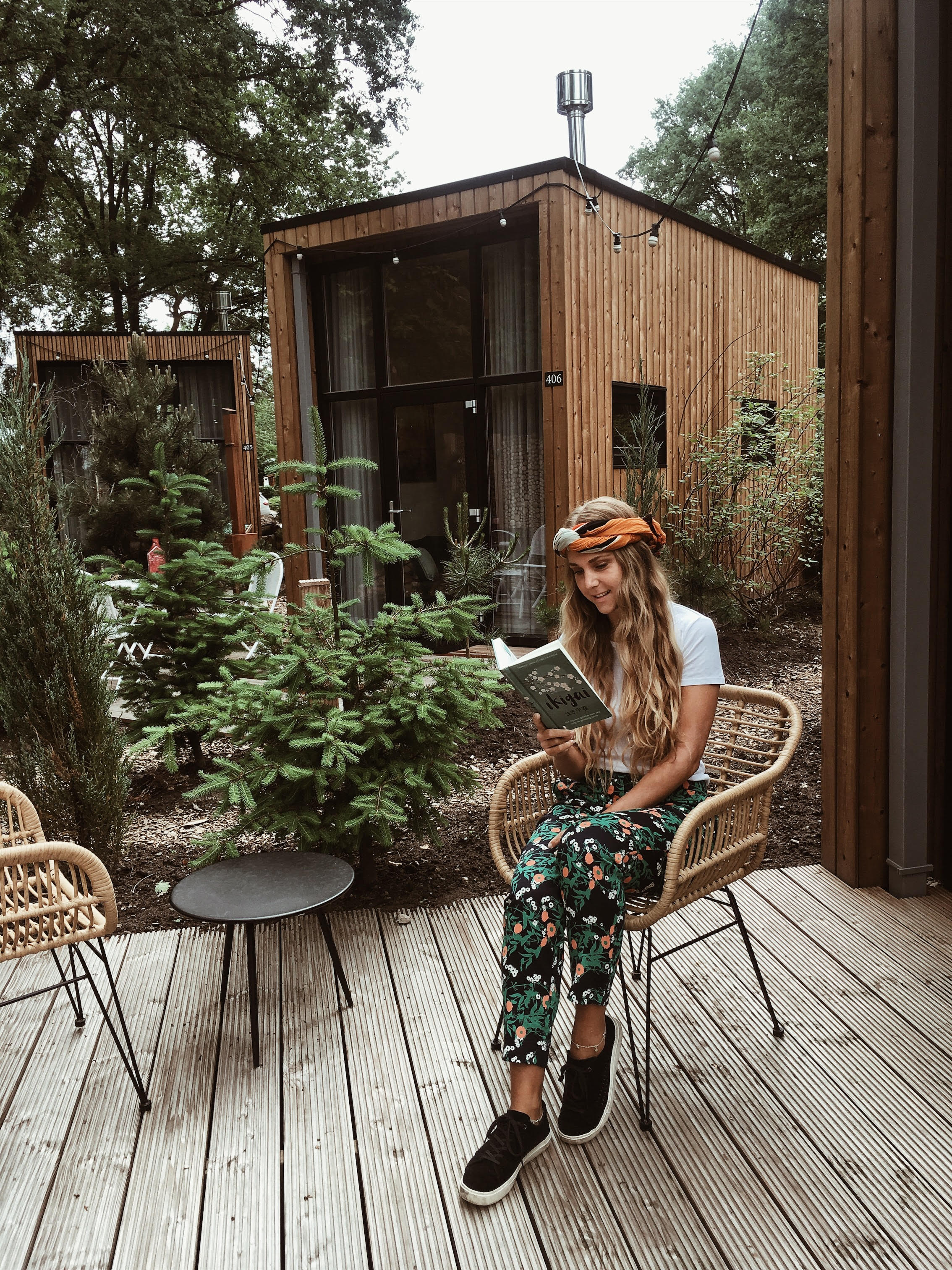 Sustainable outfit and a  tiny house . Gabriëlle wears pants from  Sophie Stone , a  Goat Organic Apparel  shirt, and  Toms  shoes.