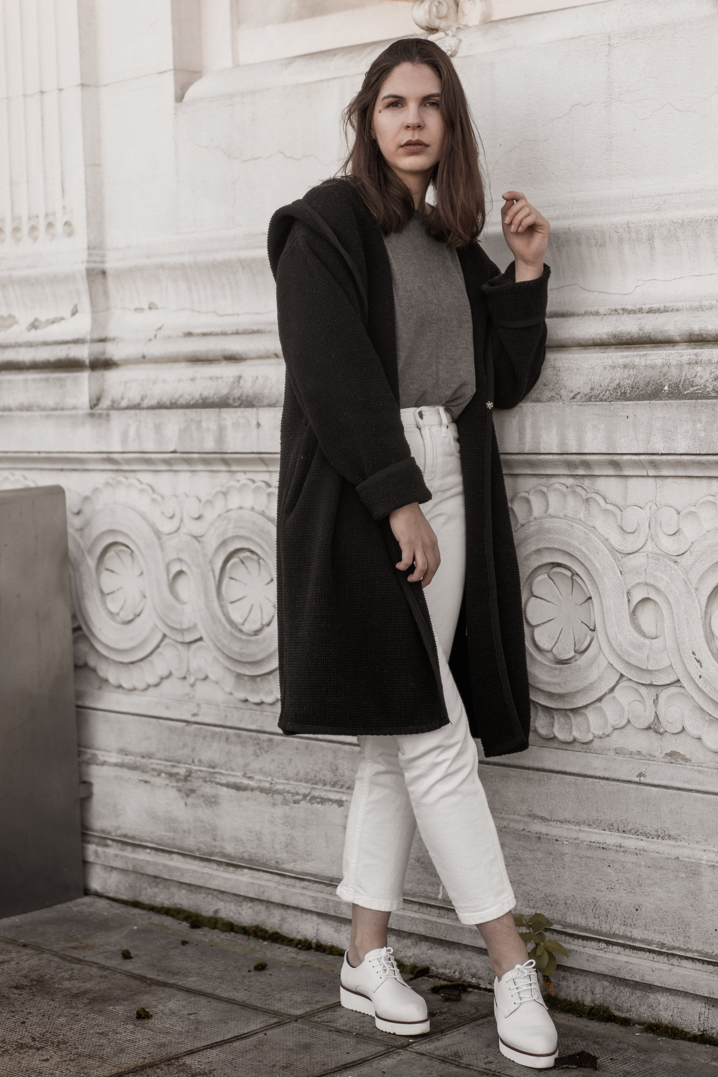 Sustainable staples— Everlane  jeans, secondhand sweater,  Printa  coat, and  Bahatika  shoes.