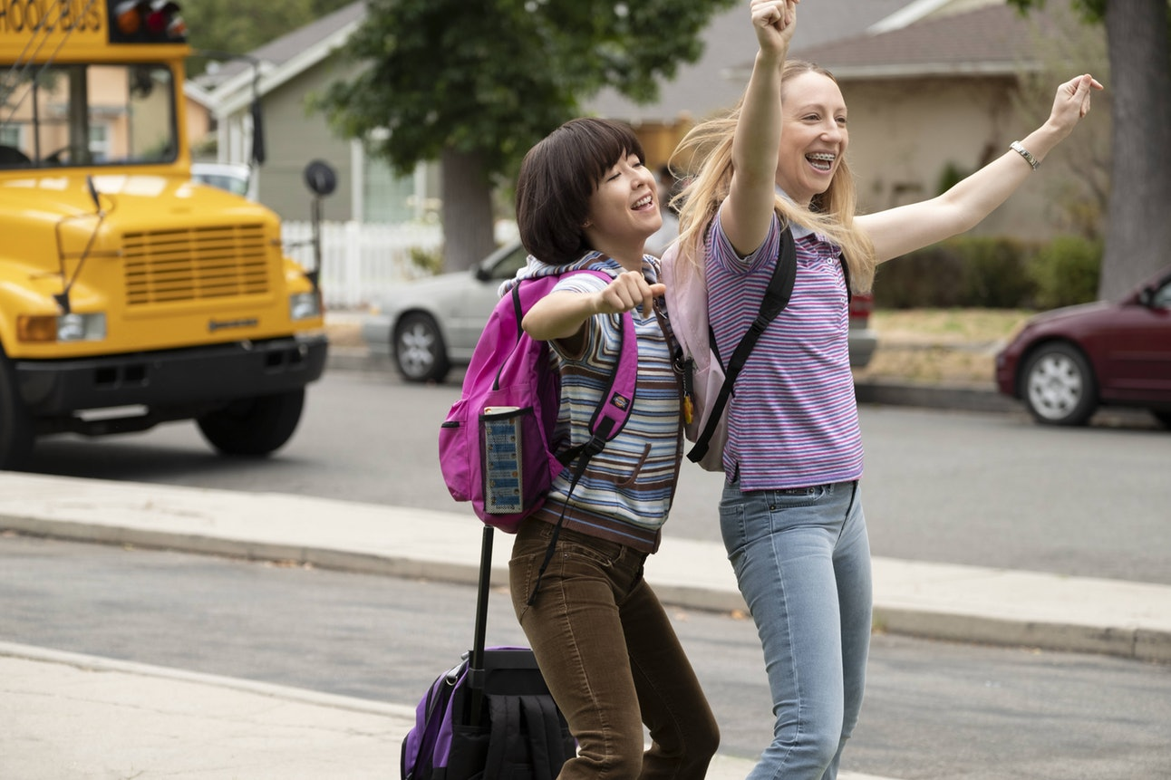 Celebrate! Rolling backpacks are fun and save the back pain!  Photo from Alex Lombardi/Hulu.