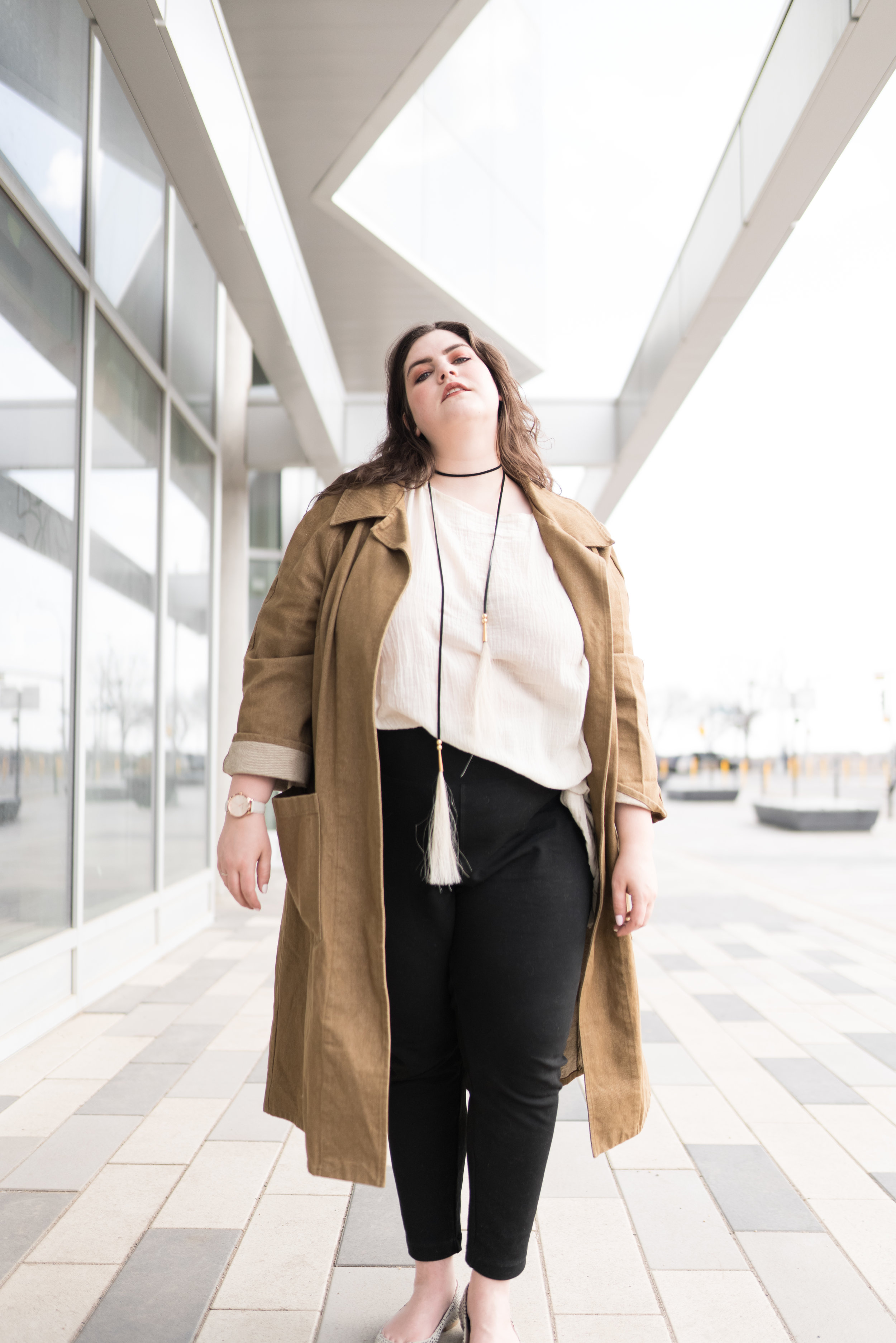 Marielle wears  Laasso  tassels with a  State the Label  coat,  UziNYC  top, and  Brass Clothing  pants.