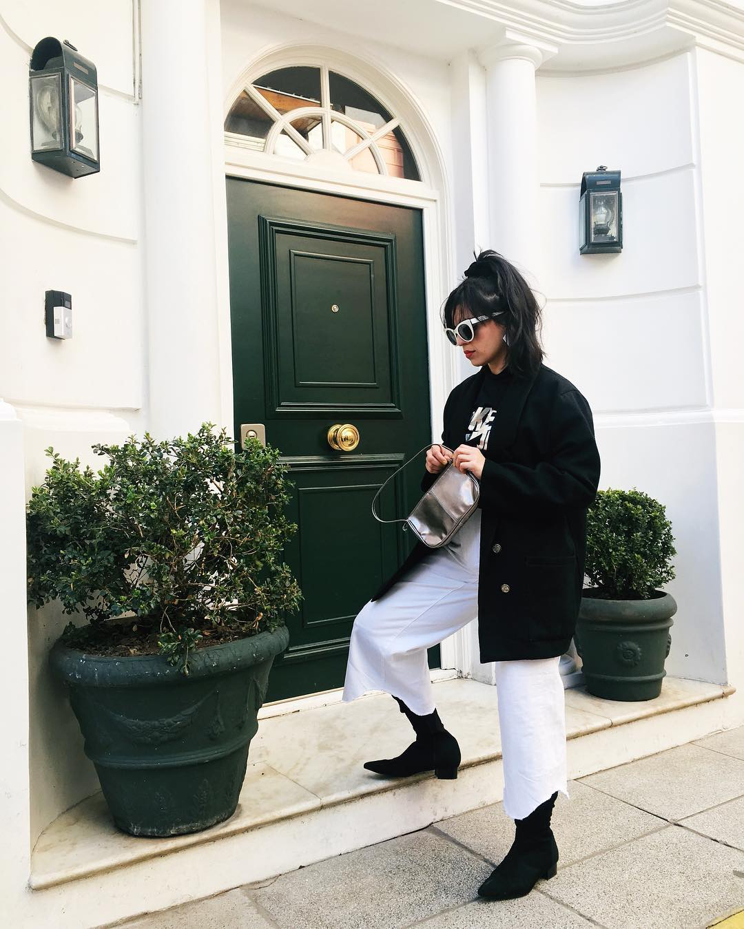 The coat is from Salvation Army, shirt is Nike Japan, and the purse is a vintage find from the charitable organization  Feria Misericordia  in Buenos Aires.