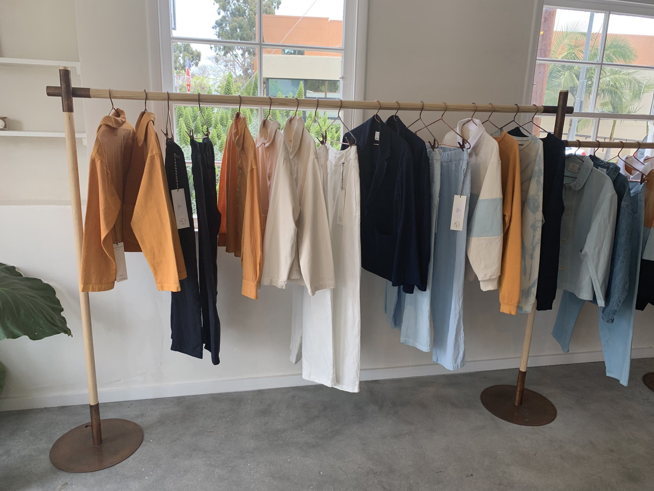 The collection of saffron and indigo-dyed pieces.