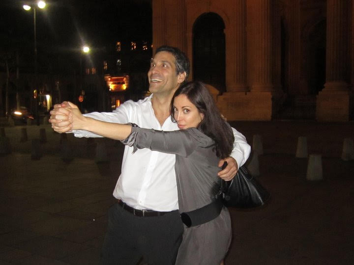 Chere with her husband dancing tago in Paris. She wears a dress by  ba&sh .