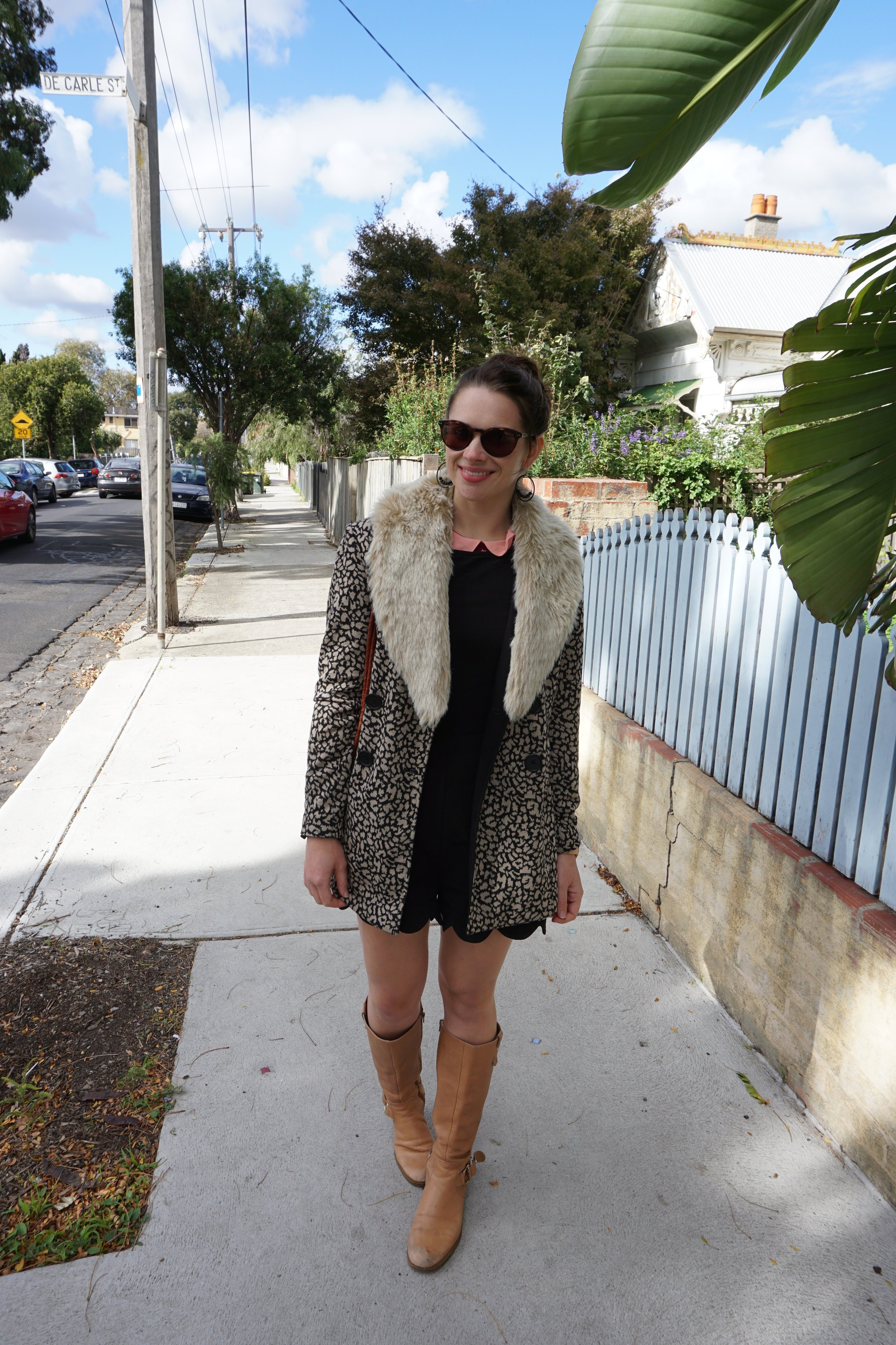 """Seattle Secondhand. Thrifted black romper from Crossroads Trading in Seattle, USA. Emily bought the jacket off of someone who was selling it on Instagram and the fur collar from a vintage market in Settle. """"This gets so much wear from me over the winter as I can put it on any coat, jacket, or blazer."""""""
