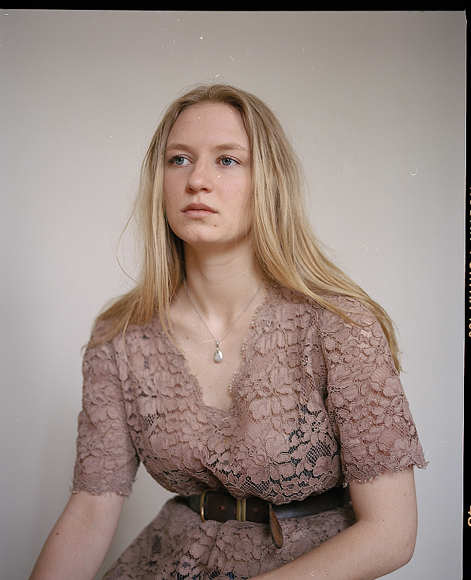 Headshots of Alina Weckström