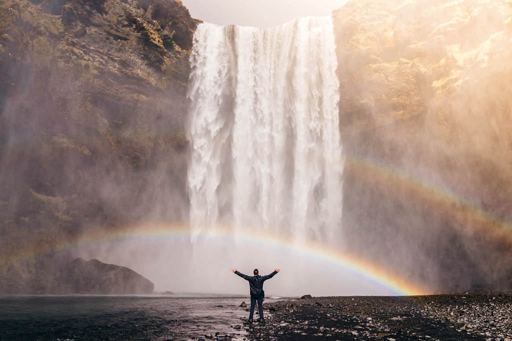 Man thankful under a waterfall.jpg
