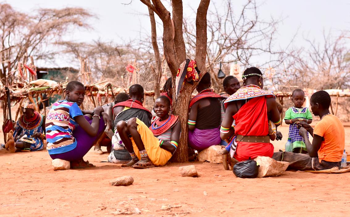 Women beading under a tree, Laikipia, Kenya