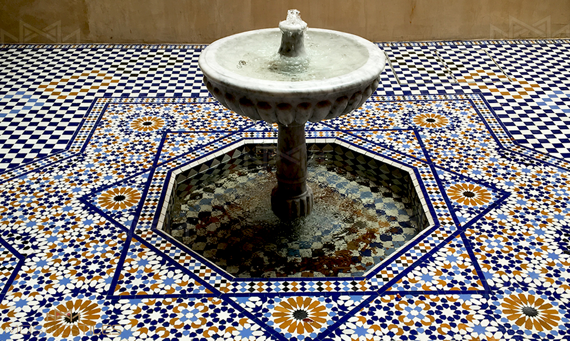 Moroccan traditionnal handmade zellige and foutain patio