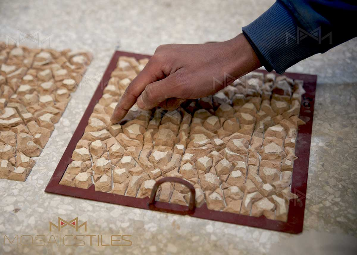 placing zelliges tiles in facility of Casablanca