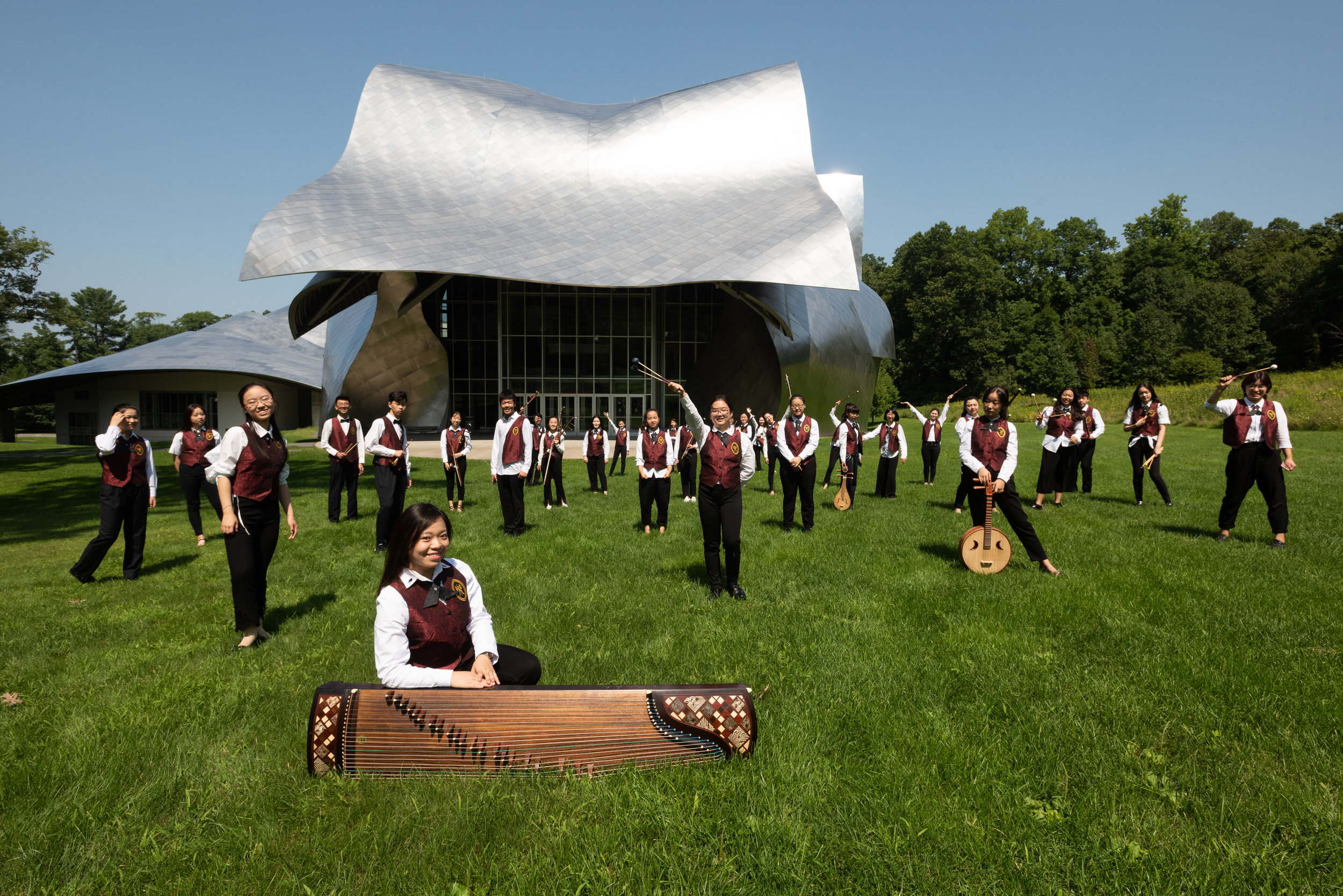 The 2018 Bard Youth Chinese Orchestra in front of the Bard College Richard B. Fisher Center for the Performing Arts. Photo by Karl Rabe.
