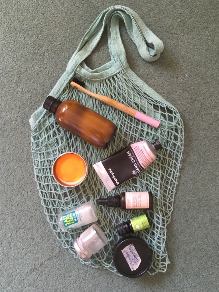 Net bag I use for groceries, as well as as a beach bag. Homemade single use plastic swaps - toothpaste, perfume, dry shampoo, bronzer. Since this photo I've also added deoderant to the mix too!