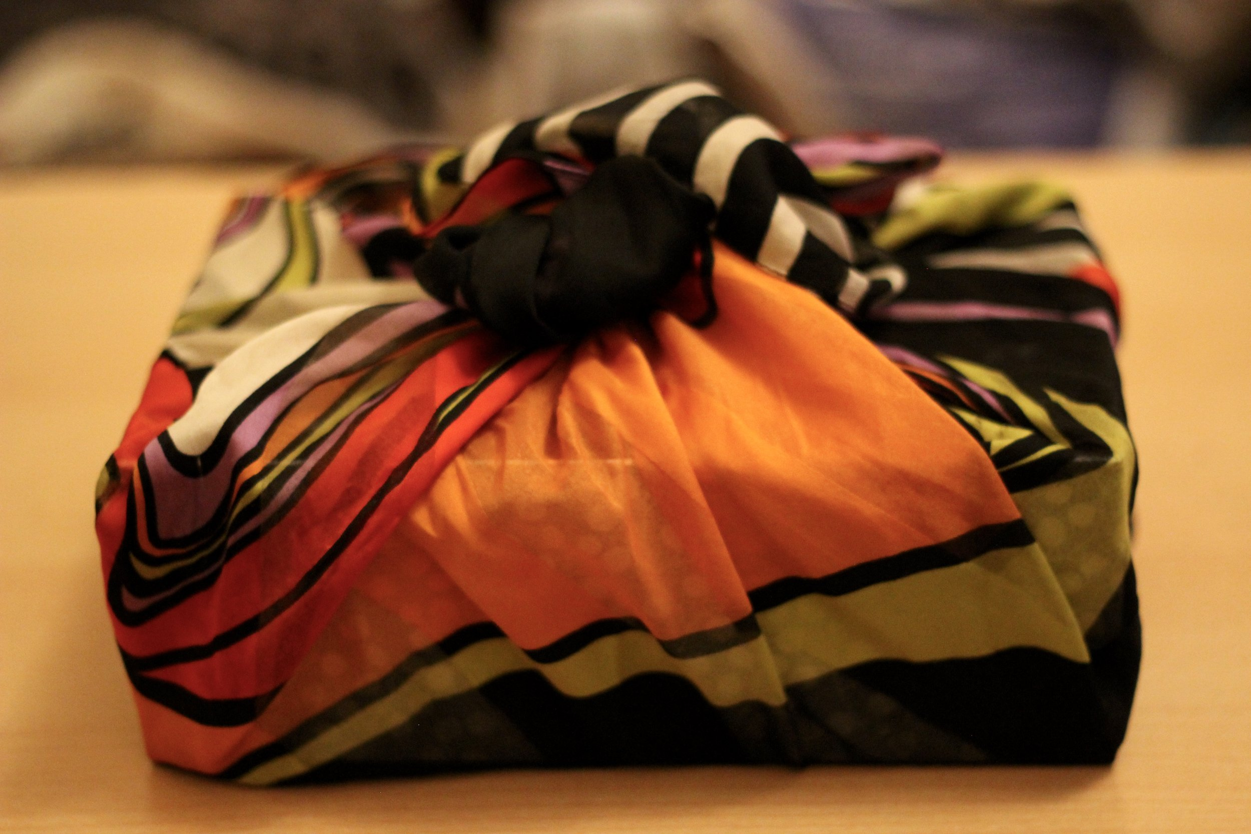 Wrapping presents up in a vintage/thrifted scarf is a great double gifting idea