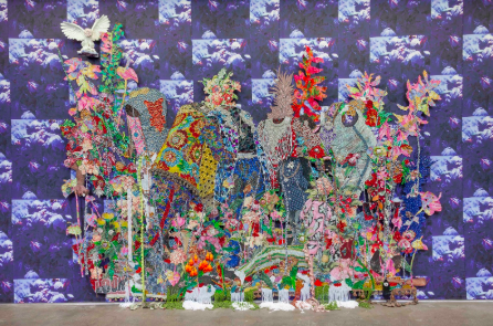 Ebony G. Patterson,  ...among the blades between the flowers...while the horse watches...for those who bear/bare witness , 2018, hand-cut jacquard woven photo tapestry with glitter, appliqués, beads, trim, brooches, feathered butterflies, fabric, silk flowers, and hand-embellished resin owl on shelf, on artist-designed fabric wallpaper, 130 x 175 in. (10.8 x 14.6 feet). Courtesy the artist and Monique Meloche Gallery, Chicago.