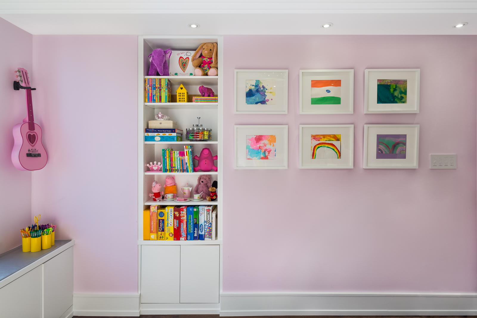 Facing the bed is the gallery wall showing artwork made by the budding artist. This of course is a rotating gallery space which can be easily updated. We designed a built in a bookcase with both open and closed storage for books, games and clutter.