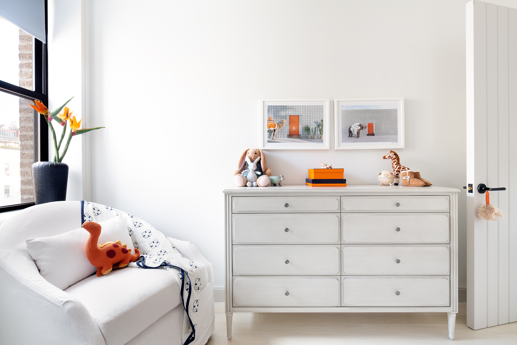 Orange is the new black, bringing in the pop of color on the functional side of the room. While the parents change and read to the little one, I brought in Hermes orange to create a luxe sophistication to the room. The overall neutral backdrop comes to life with this accent color.