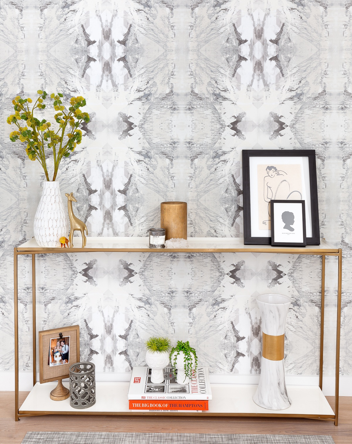 Lets talk about making a statement… this wallpaper makes for such a stunning entry. Its organic pattern brings movement welcoming you into the home. This entry is visible from every part of the great room and styled to perfection with accessories that are personal and collected.