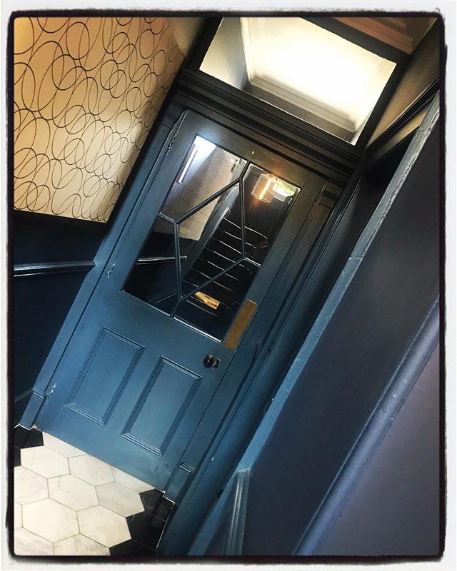 Little Greene Hicks Blue Walls, Carrara & Nera Marquita marble floor, an original Georgian door, lovely high ceiling and a touch of modern art - Quite an entrance.  #littlegreene #hicksblue #carraramarble #blackandwhite #floortiles #opticalillusion #georgianarchitecture #cityofbath #interiorsesign #entrancehall
