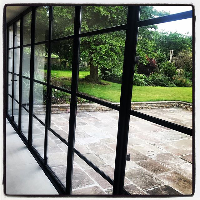 Dreamy run of doors for a client's Garden Room.  #crittall #beautifullines #frametheview #gardenroom #black #landscaping #portlandstone #interiordesign #architecture