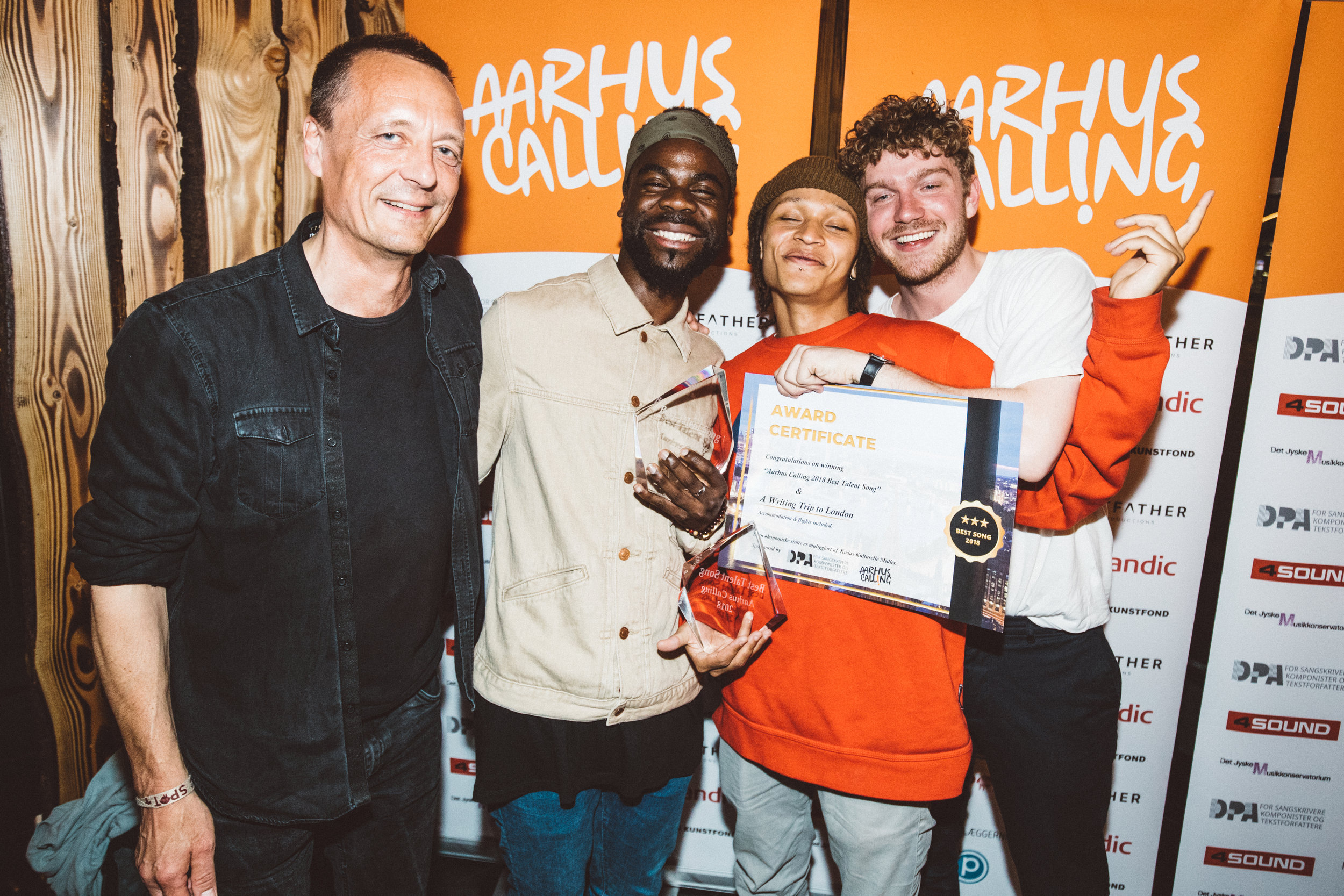 "DPA & Koda chairman Niels Mosumgaard with the winners of ""Aarhus Calling 2018 Best Talent Song"": Olivio Antonio, Elias Segujja & Martin Plauborg.."