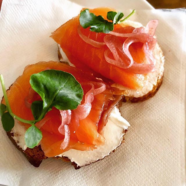 House cured salmon crostini on robiola with pickled shallots and watercress. #miniloxandschmear #saturdaybrunch