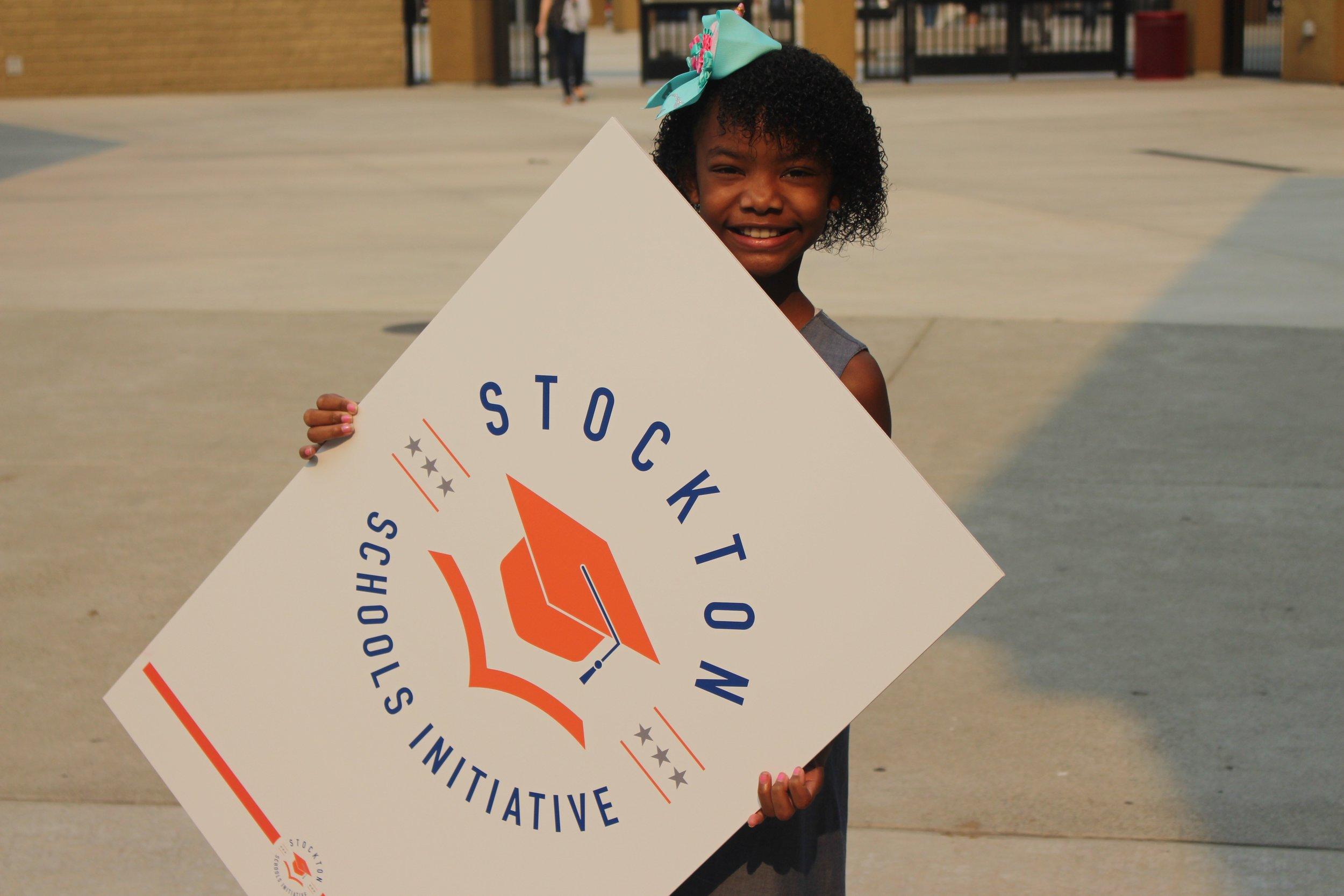 child with Stkn Sch Initiative logo.jpg
