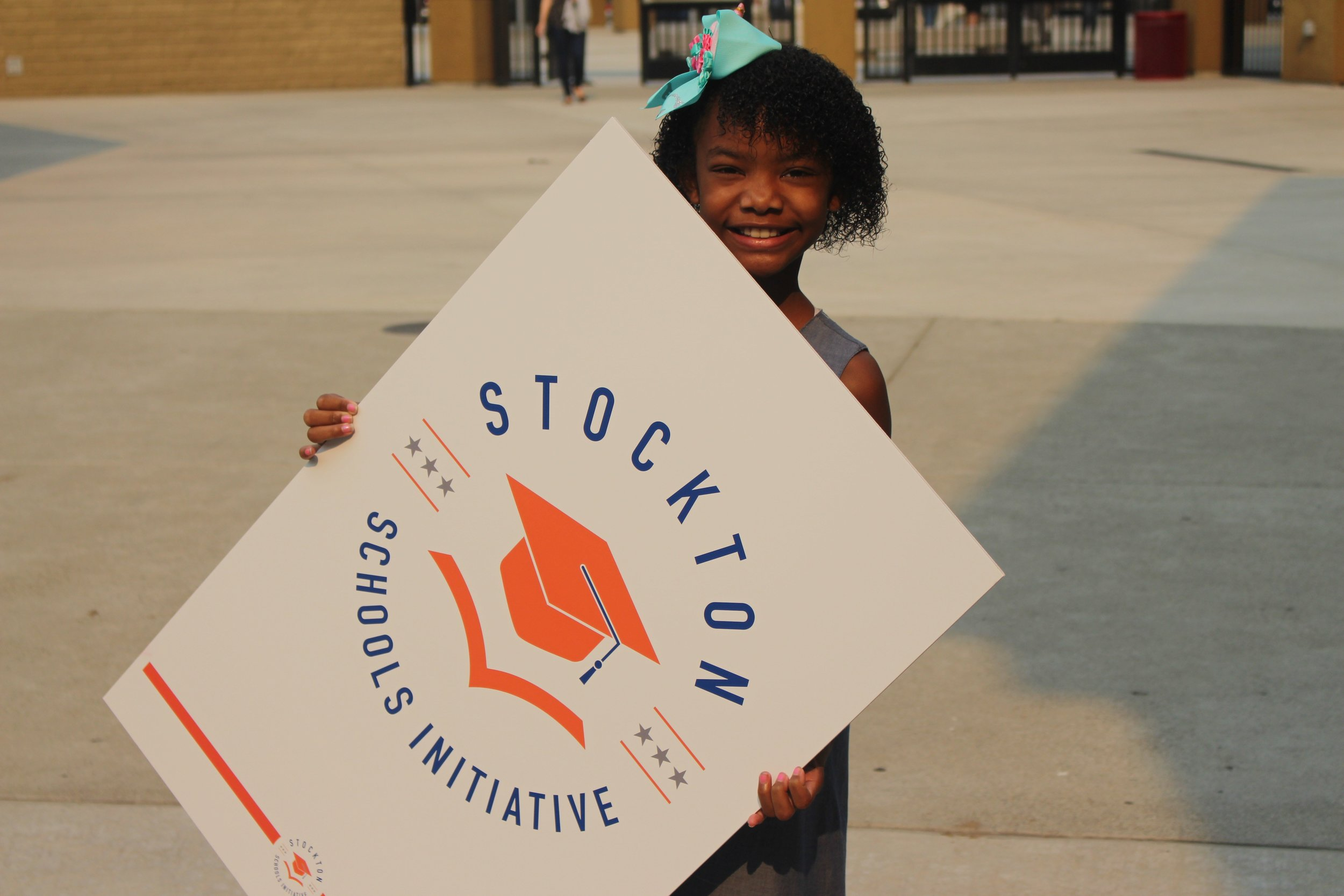 child with Stkn Sch Initiative logo.jpg