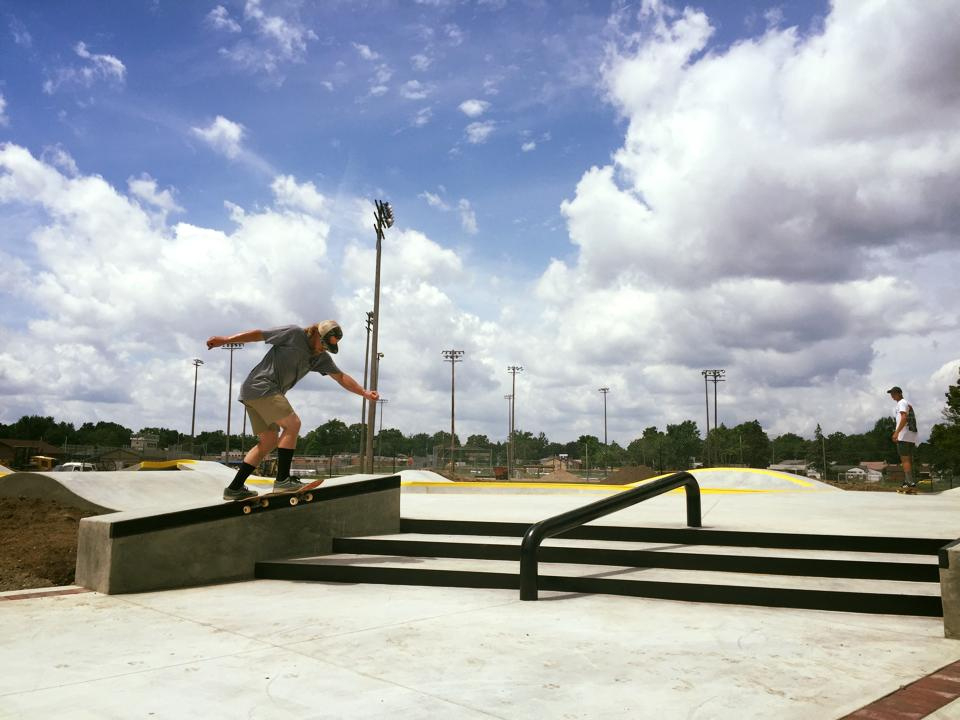Crew member Jesse Clayton with a backtail on the skate path