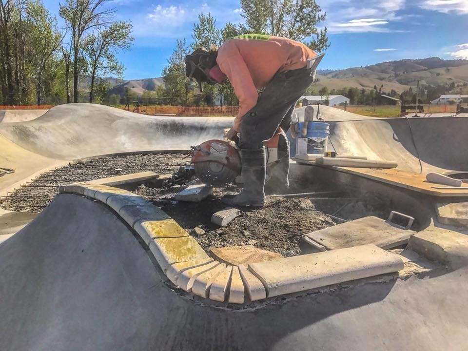Lance Spiker puts together the pool coping island