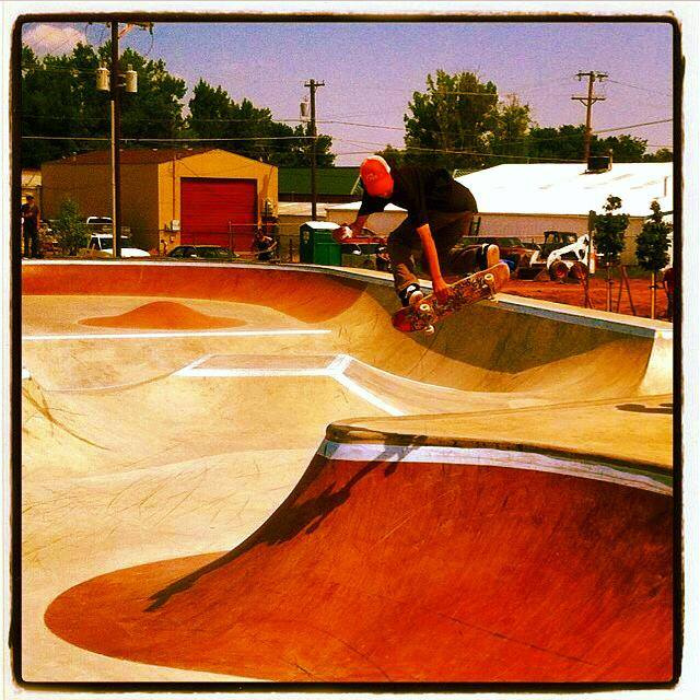Jaeson airs over the hip at the Milliken, Colorado Skatepark