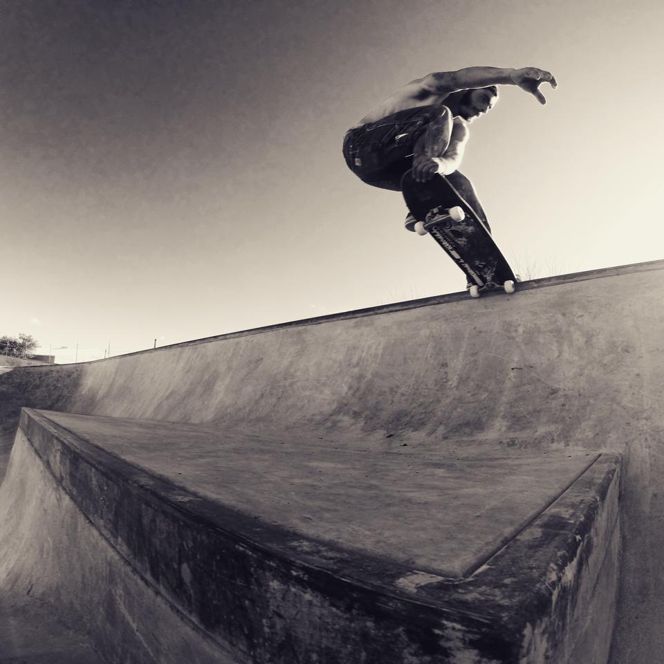 Sloan Palder crailslide over the ledge at the Fredericksburg, Texas Skatepark