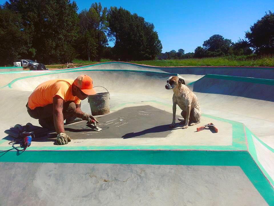 Tavita & Heyla the dog put the finishing touches on the Hernando, Mississippi Skatepark