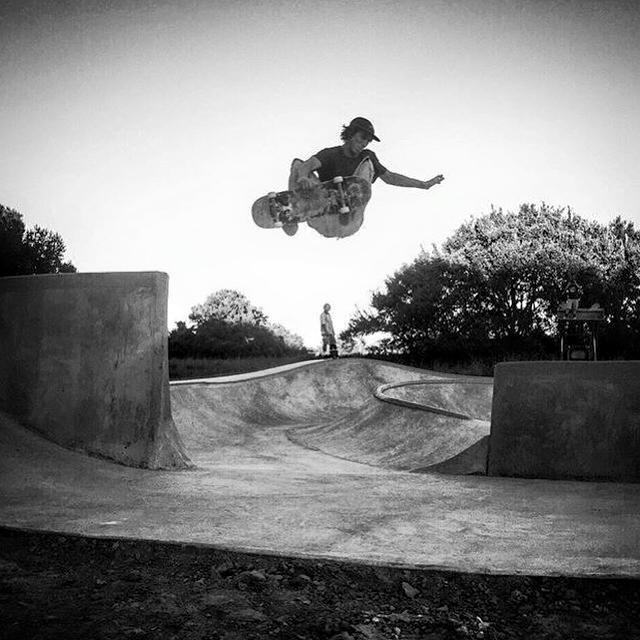 Crew member airs over the channel at the Hernando, Mississippi Skatepark