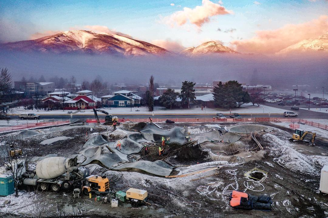 Where the mountains stop & the skatepark begins. Snowy mornings on site in Hamilton, Montana.
