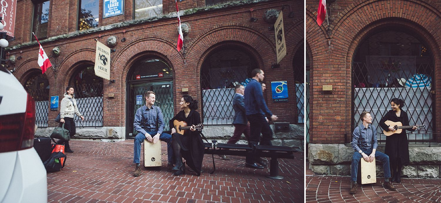 Angel and Tim play the guitar and box drum on the streets of Gastown for their engagement photo session