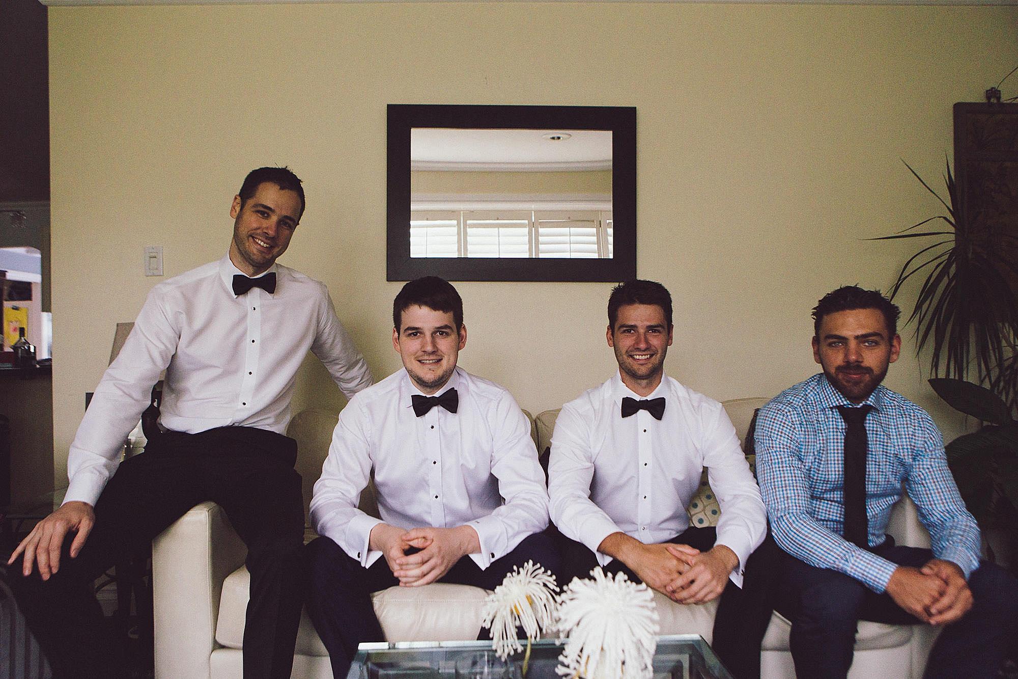 Groomsmen pose for a photos