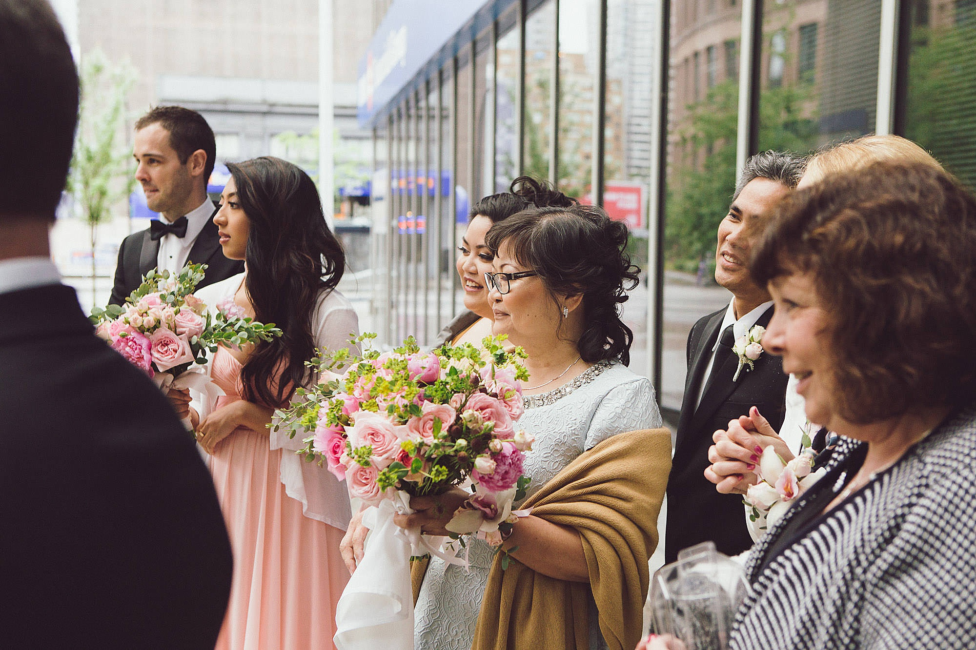 Family and wedding party react to First Look