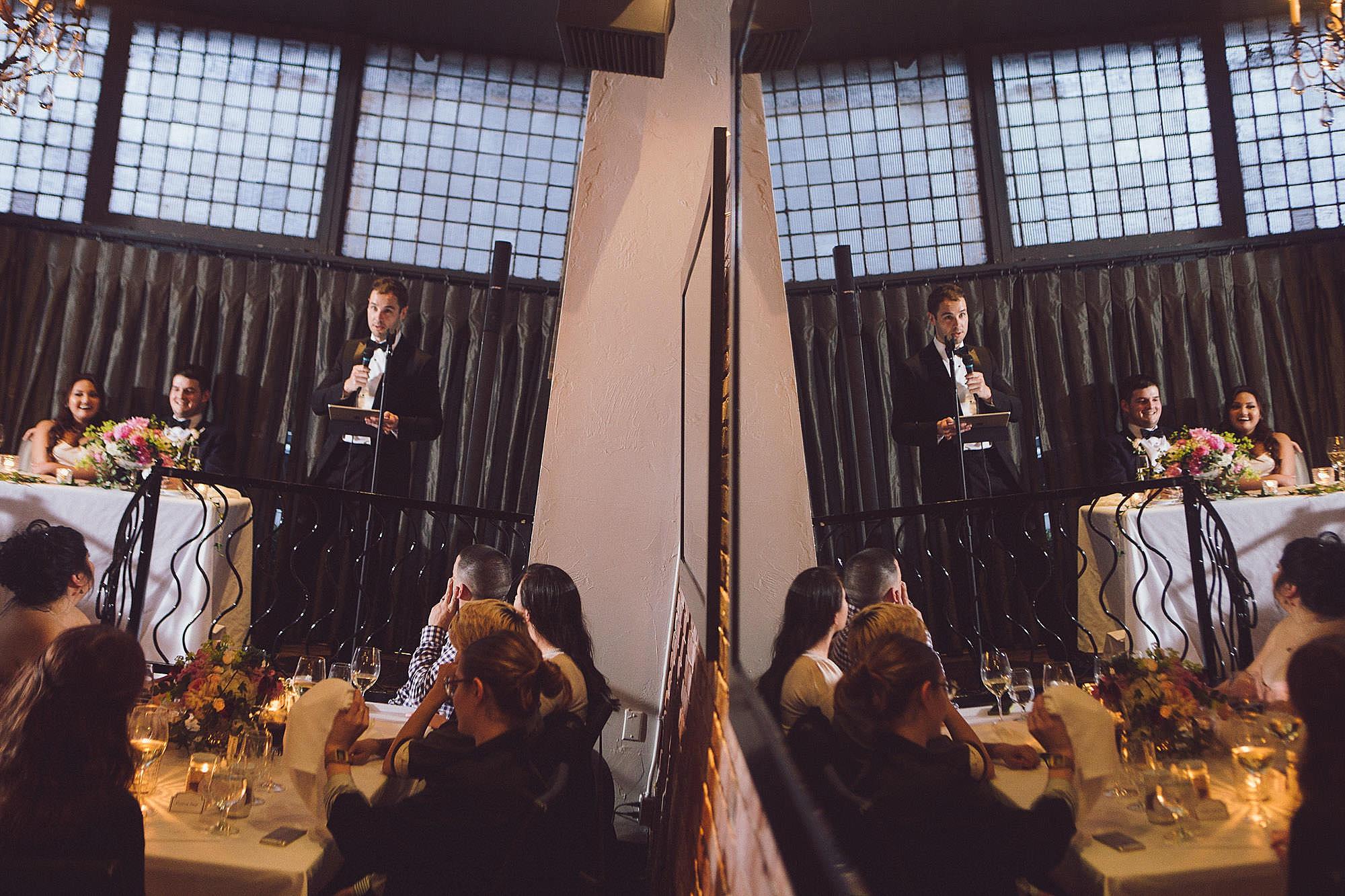 Best man gives speech at reception