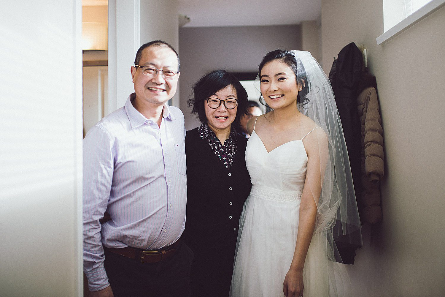 Bride stands with mom and dad