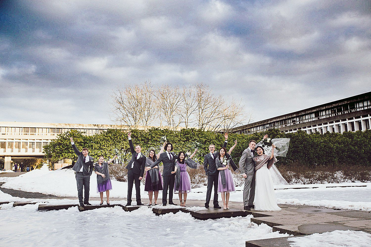 Wedding party stands by the Reflecting Pond at Simon Fraser University