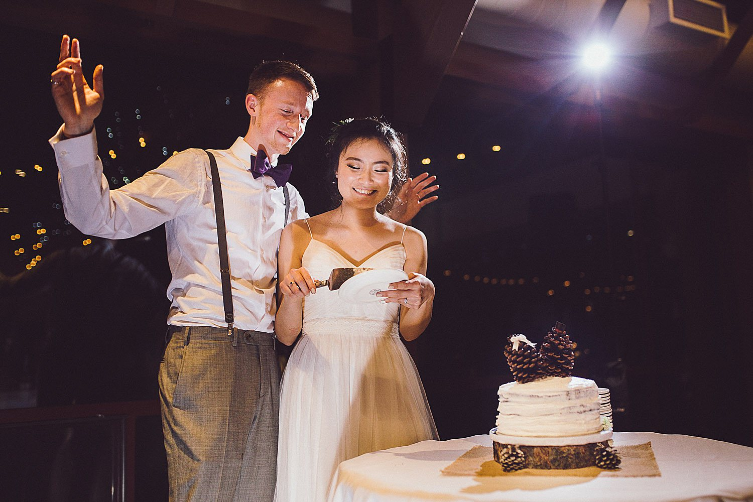 Angel and Tim cut their wedding cake at the DAC