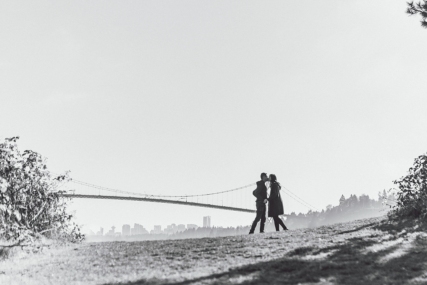 Couple dancing in front of the Lions Gate Bridge
