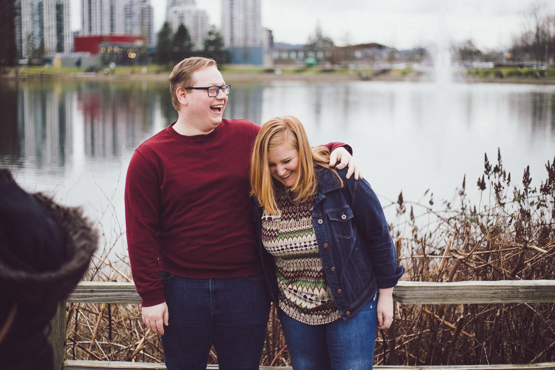 Laughing engaged couple at Lafarge Lake.jpg