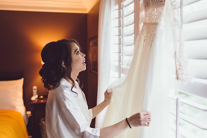 04_ALP - DomAaronBlog - 8_at_bride_looking_dress_Wedding.jpg