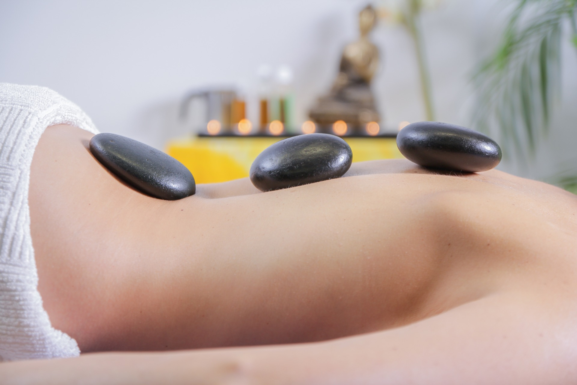 Ultimate Hot Stone Massage at Spa Rockaway features basalt stones to rejuvenate on a deeper level.