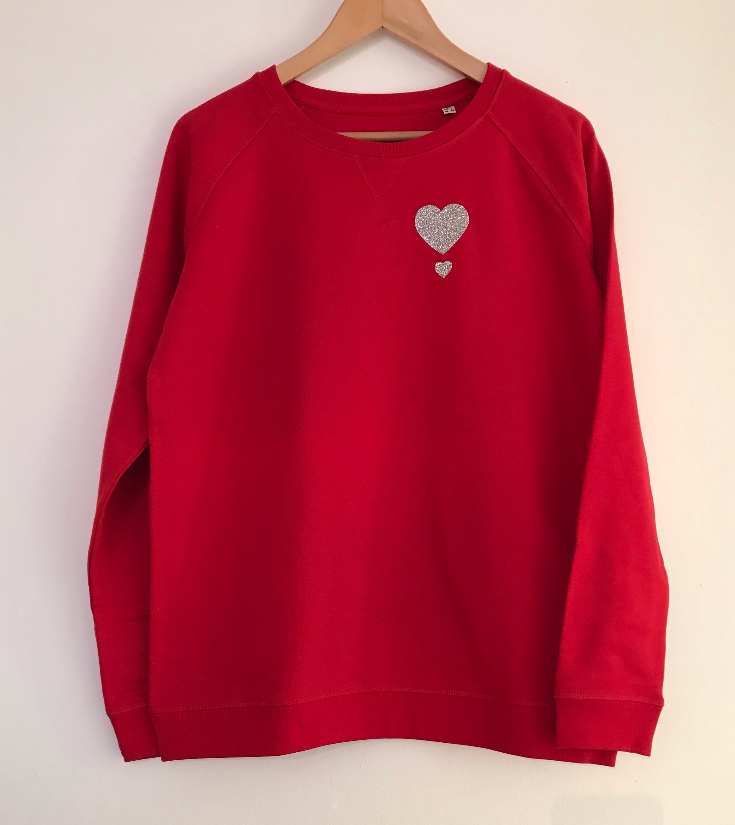 MY ONE HEART LADIES SWEATSHIRT - Founder of My One Heart Laura, has not only created a gorgeous collection of sweatshirts and T-shirts, but purchasing from the My One Heart range, helps raise money and awareness for defibrillators I want everyone to be aware of the importance of having easily accessible defibrillators in public places. From every sale of my products, £5.00 will go towards putting 24-hour defibrillators in public places around the UK.Money raised will go to Heart 2 heart Norfolk.
