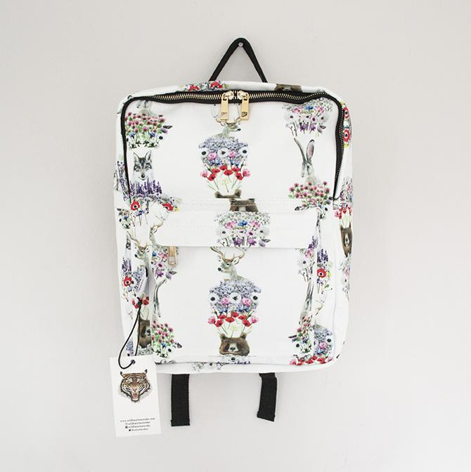 NORDIC ANIMALS BACKPACK - Wild Hearts Wonder is a brand that creates modern, unique and beautiful clothing and interiors for children. Started by two sisters who feel passionately about igniting children's imaginations, they spent their own childhood growing up by Epping Forest in London, enabling them to enjoy the beauty of the wilderness. They want to inspire children to think creatively, and encourage a love of wildlife and nature.This floral, pretty and practical Nordic Animals backpack is in a modern boxy shape, digitally-printed in our hand-painted animal print. The backpack has a soft pale grey lining, and internal pockets suitable for a water bottle, and an ipad. It's finished with pale gold hardwear, it has a handy top handle, and adjustable back straps. Made from 100% heavy duty twill, this backpack is as durable as it is beautiful.