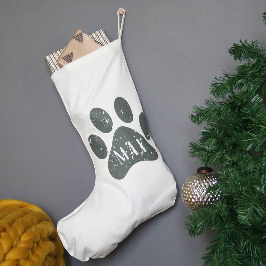 PERSONALISED PAW PRINT CHRISTMAS STOCKING - Having found a distinct lack of modern and inspiring art work for their little person's nursery - Modo Creative decided to make their our own. They wanted beautiful colours, quirky design and an inspiring message. Since the early days we have grown our range from just a few personalised prints to a whole range of gifts for every occasion.A lovely modern paw print name christmas stocking.Now your beloved pets can get in on the festive action with thier very own stocking! This stocking is made from quality heavyweight white cotton fabric and printed with your choice of pet name. Made locally to meet our specifications and high standards, Children and adults alike will love the simple festive design and the quality means it will last for years to come.