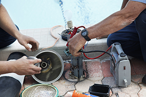 Men Working On Pool Equipment